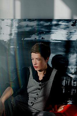Portrait of a female painter resting in her studio - p300m2170702 by Oxana Guryanova