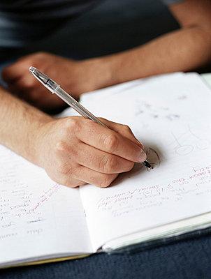 Teenage boy doing homework - p92410753f by Image Source