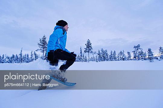 Woman snowshoeing in Winter landscape
