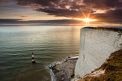 Beachy Head lighthouse at high tide with sunset light - p1516m2158283 by Philip Bedford