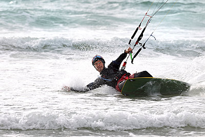 France, man kitesurfing - p300m979005f by Albrecht Weisser