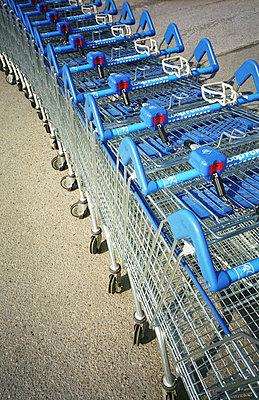 Grocery carts in a row - p1418m1571627 by Jan Håkan Dahlström