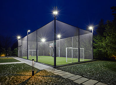 Outdoor sports facility with soccer field and tennis court - p390m2185880 by Frank Herfort