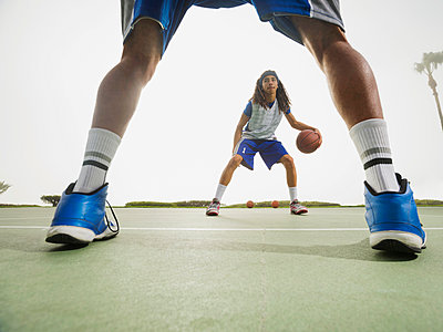 Basketball teams playing on court - p555m1415517 by Erik Isakson
