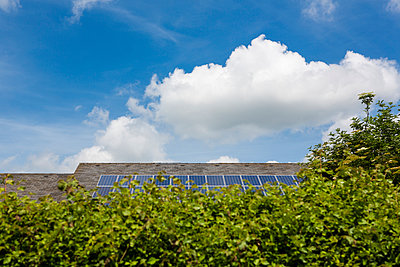 Solar panels on a roof - p1057m916759 by Stephen Shepherd