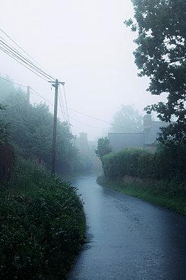 Misty street in Brittany - p470m2064947 by Ingrid Michel