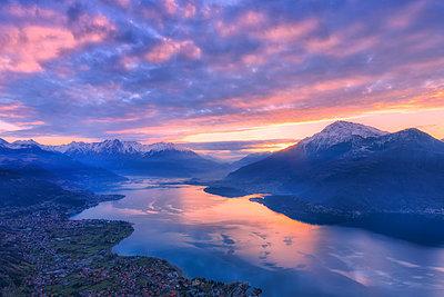 Stunning sunrise over the village of Dongo and Como Lake, from above. San Bernardo Church, Monte Bregagno, Dongo, Como Lake, Lombardy, Italy. - p651m2032931 by Francesco Bergamaschi