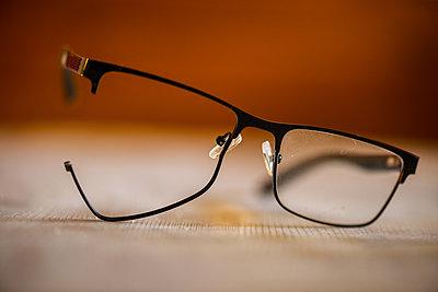 Broken glasses with one lens missing - p1418m2263420 by Jan Håkan Dahlström