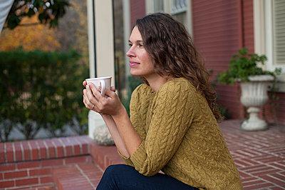 Woman drinking tea - p920m989905 by Jude Mooney