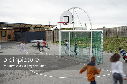 a school teacher gives a sport class in the recreation yard - p1610m2233883 by myriam tirler