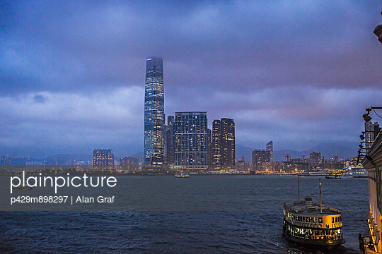 City and ferries at night - p429m898297 by Alan Graf