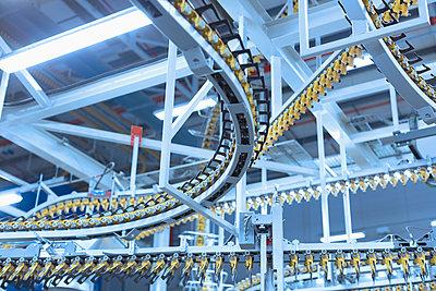 Winding printing press conveyor belts overhead - p1023m1105806f by Martin Barraud