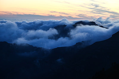 Cloud cover over Gomera mountains  - p1643m2229381 by janice mersiovsky