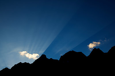 Low angle view of silhouette mountain against blue sky during sunset - p1166m2035187 by Cavan Social