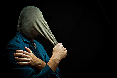 Businessman head covered by strange fabric  - p1165m952582 by Pierro Luca