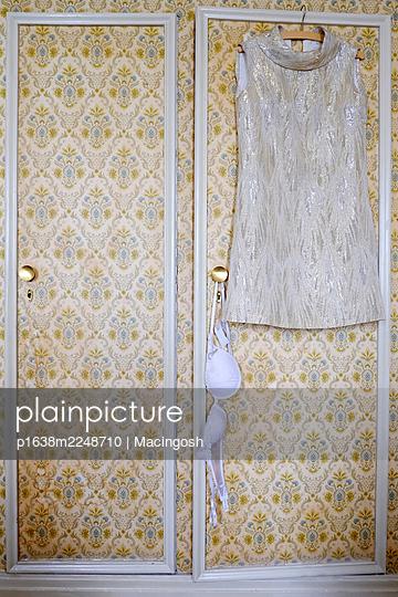 Mini dress and bra on wall cupboard - p1638m2248710 by Macingosh