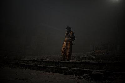 Sadhu man at night dressed in orange   - p1007m1144326 by Tilby Vattard