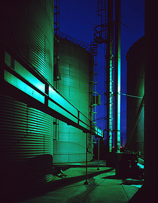 Storage silos at night - p555m1303632 by Tom Paiva Photography