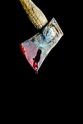 A rusty axe dripping with blood, against a black background - p1302m2142100 by Richard Nixon