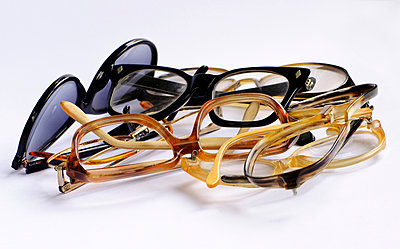 Various spectacle frames against white background - p1695m2290946 by Dusica Paripovic