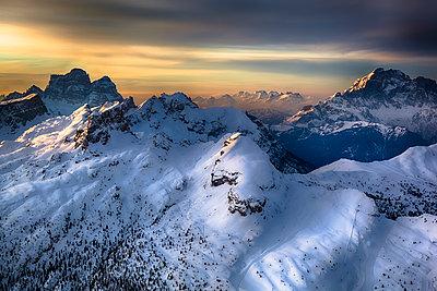 Italian Alps in winter at sunset - p300m1081564f by Giorgio Fochesato