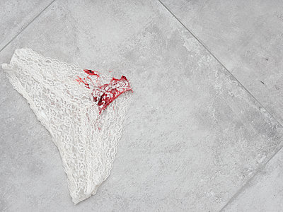 Bloody underpants on the tiled floor  - p1383m2262379 by Wolfgang Steiner