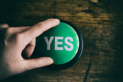 Hand touching Yes button - p1190m1515642 by Sarah Eick