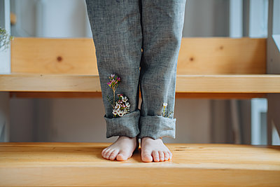 Child standing on wooden steps - p1414m2044894 by Dasha Pears