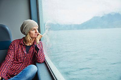 Chile, Hornopiren, woman looking out of window of a ferry - p300m2070784 by Stefan Schütz