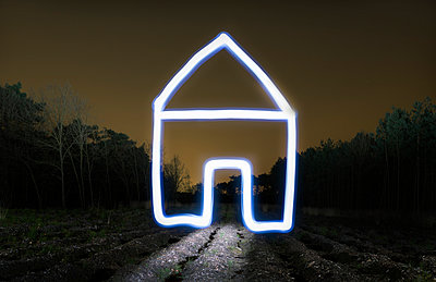 Field landscape at night with light painted drawing of house - p429m929024f by Mischa Keijser