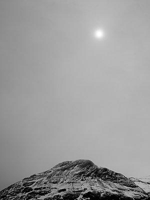 Sun above mountain peak - p312m935498f by Pia Ulin