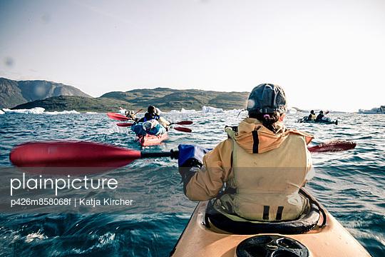 Rear view of mature woman kayaking on sea - p426m858068f by Katja Kircher