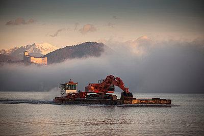 Excavator on barge,  Lake Maggiore, Varese, Piemonte, Italy - p429m911534f by WALTER ZERLA