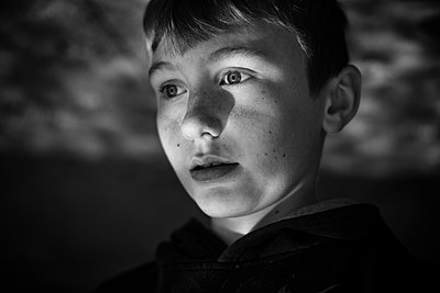 Boy staring off - p1169m2108453 by Tytia Habing