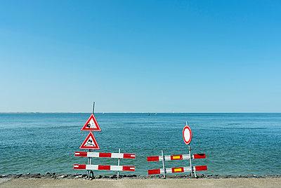 Traffic signs along shoreline - p429m2019589 by Mischa Keijser
