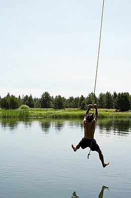 Man on ropeswing - p6350044 by Julia Kuskin