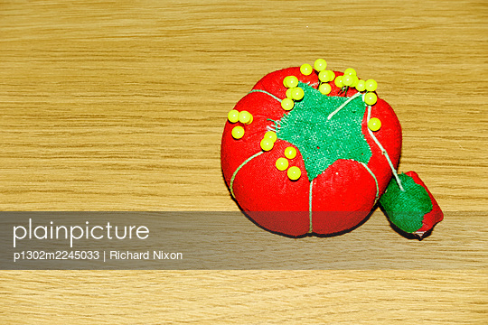 Small red pin cushion with yellow pins - p1302m2245033 by Richard Nixon