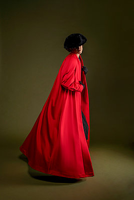 Woman with red coat - p1554m2158875 by Tina Gutierrez