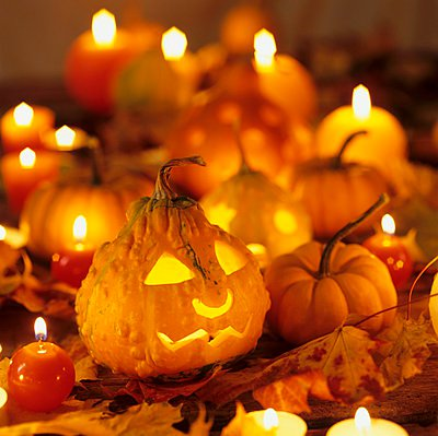 Several pumpkins and candles for Halloween - p1183m996360 by Hrbkov���, Alena