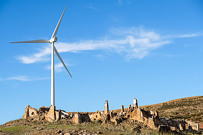 Wind turbine towering over old farmhouse ruin; Almargen, Malaga, Andalucia, Spain - p442m2074172 by Michael Thornton