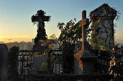 Cemetery against high rises  - p491m1119183 by Ernesto Timor