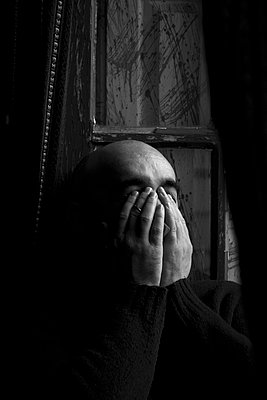 Man covering his face with hands - p388m877087 by Barbosa