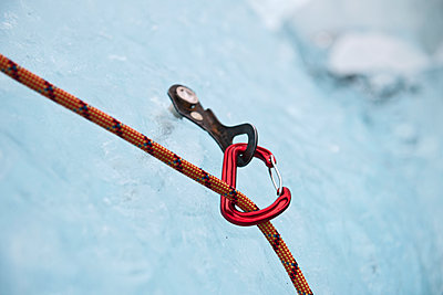 karabiner attached to ice screw on iceberg in the south of Iceland - p1166m2269494 by Cavan Images