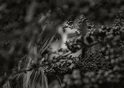 Girl Looking through Branches - p1503m2020411 by Deb Schwedhelm
