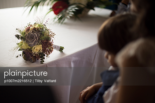 Bridal bouquet on a table - p1007m2216512 by Tilby Vattard