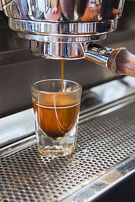 Espresso shot being poured from espresso machine, Seattle - p1100m876875f by Paul Edmondson