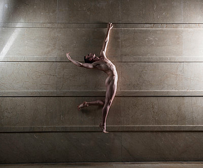 Naked man takes a leap - p1139m1503045 by Julien Benhamou