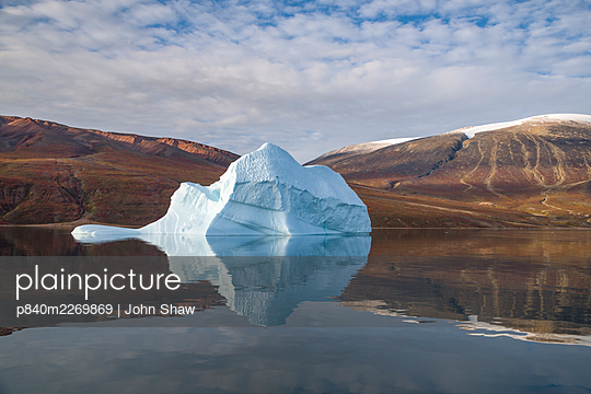 Iceberg and reflection, in Rode Fjord (Red Fjord), Scoresby Sund, Greenland, August. - p840m2269869 by John Shaw
