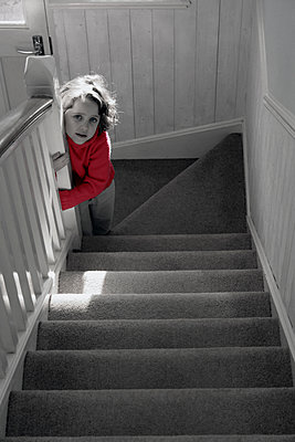 Girl at the bottom of the stairs - p1121m1539627 by Gail Symes