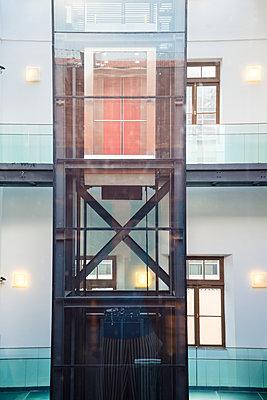 Interior courtyard with glass elevator - p1170m1111610 by Bjanka Kadic